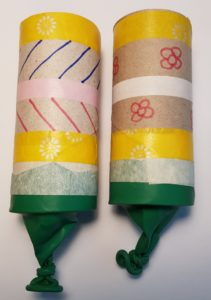 Confetti poppers made from toilet roll cores