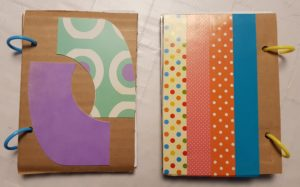 Notebooks made with cardboard packaging and unwanted greeting cards