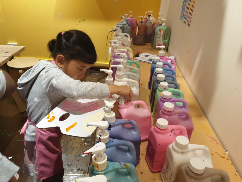 Choosing fabric paint from a myriad of colours